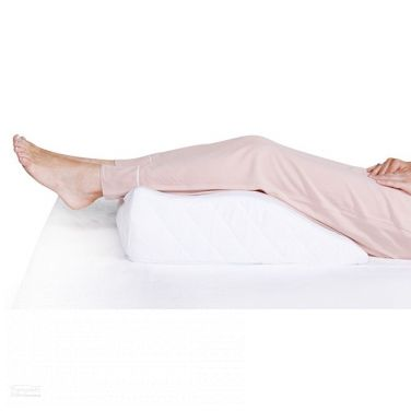 Foot reliever women legs up on cushion