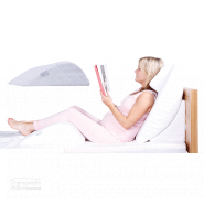 Knee realxer support women sitting in bed reading a book